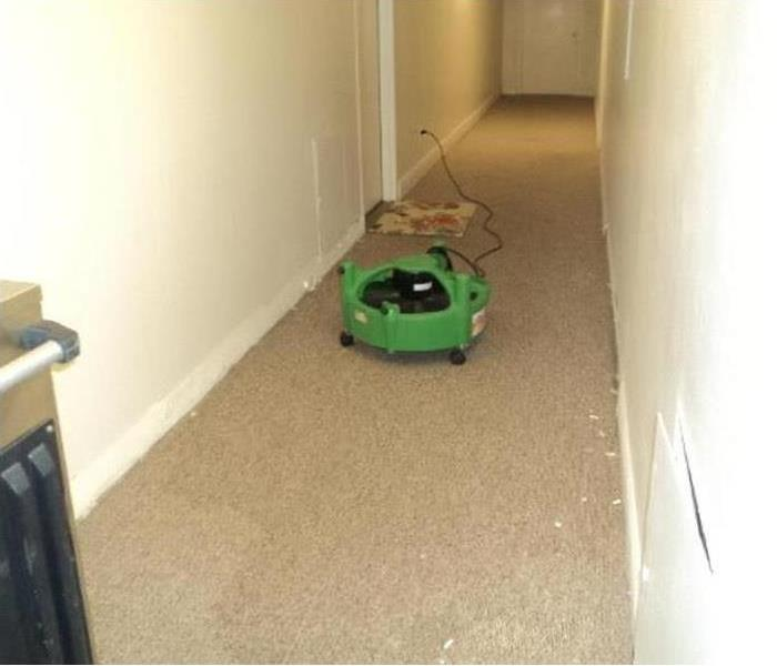 SERVPRO drying equipment sits on a dry floor, having removed the water.