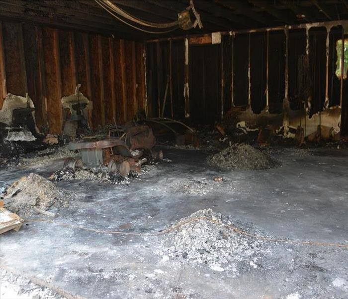 The inside of a garage after a devastating fire.